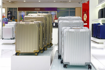 XIAMEN, CHINA -16 JUN 2019- Display of colorful metal suitcases in a Rimowa store. Rimowa is a German company known for its sturdy aluminum and polycarbonate sturdy carry-on luggage.