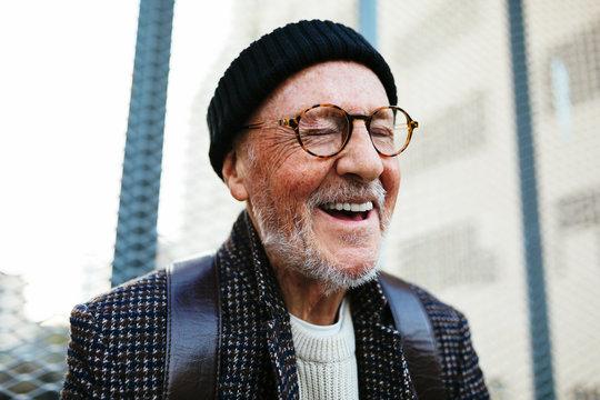 Close up of senior man smiling outdoors