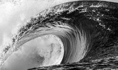 Close up of a huge and powerful wave breaking, Tahiti black and white