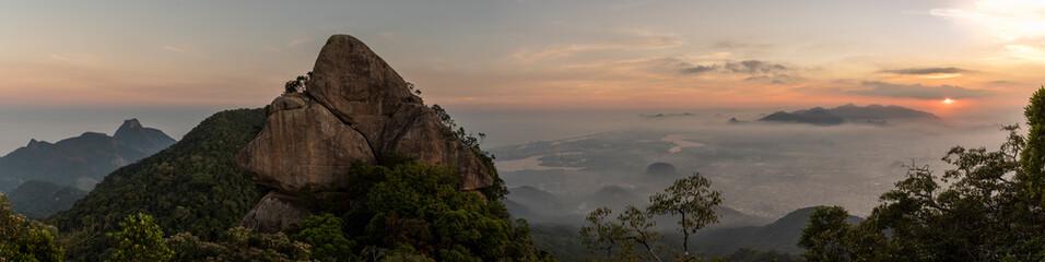 Landscape of rocky mountain peak on rainforest sunset