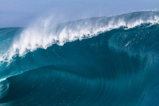 Close up of a huge and powerful wave breaking in Tahiti