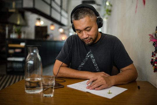 Man listening music on headphones