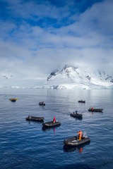 Inflatable boats and snow covered mountains