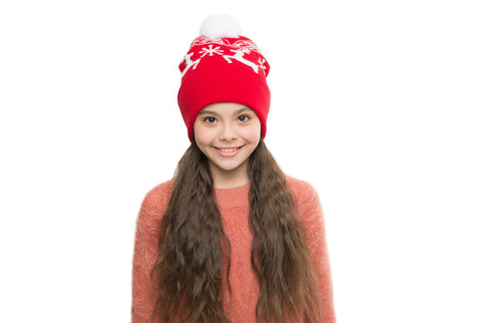 Cozy winter outfit. Little kid wear knitted hat. Stay warm this winter. Happy little girl winter fashion accessory. Small child smiling in fur hat white background. Cute model enjoy winter style