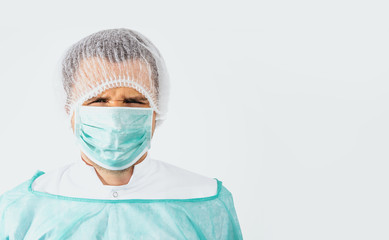 Angry and frustrated surgeon after surgery dressed in a green surgical apron and face mask on a...