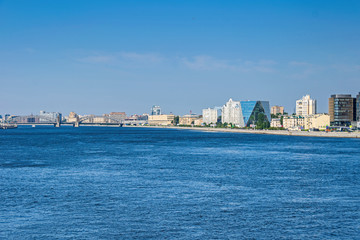 Malookhtinskaya Embankment with Bolsheokhtinsky Bridge and modern buildings of Leorsa Group in Saint Petersburg, Russia