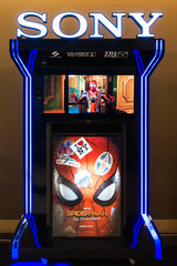 Bangkok, Thailand - Jun 24, 2019: Spider-Man: Far From Home poster and TV screen kiosk display showing movie trailer in theatre. Cinema promotional advertisement, or film industry marketing concept