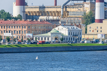 Sinopskaya Embankment with the Eukterion of the Orthodox Valaam Monastery and thermal power station in Saint Petersburg, Russia