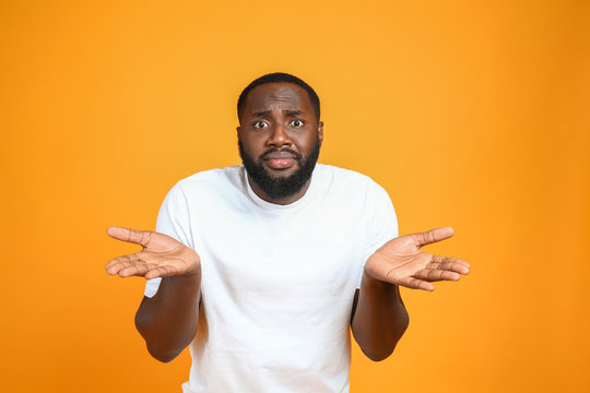 Helpless African-American man on color background