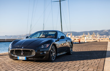 MUGGIA, ITALY MARCH 16, 2013: Photo of a Maserati GranTurismo S . The Maserati GranTurismo is a two-door, four-seat coupé produced by the Italian car manufacturer Maserati.