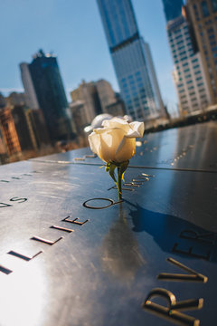New York City, USA - March 20, 2017 : Ground Zero 9/11 Memorial geometric architecture and buildings. The Memorial honors people killed in the terror attacks of September 11, 2001