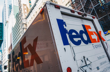 New York City, USA - March 21, 2017: FedEx van parked on the street in low Manhattan. FedEx Corporation is an American global courier delivery.