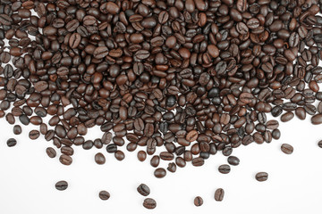 Brown coffee beans on a white background With copy space.