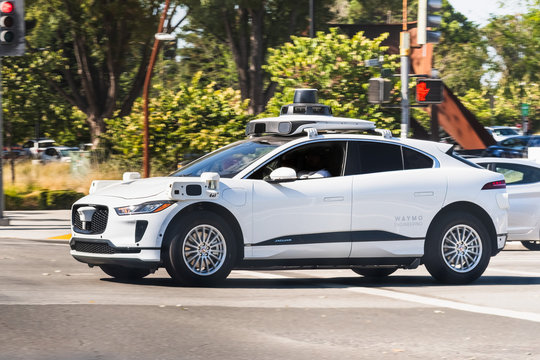 Sep 26, 2019 Mountain View / CA / USA - Waymo (a subsidiary of Alphabet) self driving car performing tests on a street near Google's offices, using a Jaguar electric vehicle; Silicon Valley