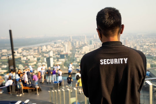 Bangkok, Thailand - September 27 2019: Security guard on MahaNakhon Building, Mahanakhon skywalk, observation deck 314 meters the peak glass tray.