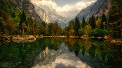 lake in the mountains of Mello Valley, autumn season, Italy