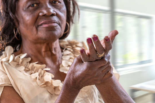 African woman Elderly woman suffering from wrist pain From Rheumatoid Arthritis at home