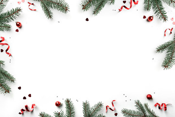 Creative frame made of Christmas fir branches on white background with red decoration, pine cones. Xmas and New Year greeting card, winter holiday. Flat lay, top view Fotobehang