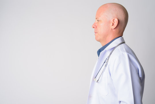 Closeup profile view of mature handsome bald man doctor