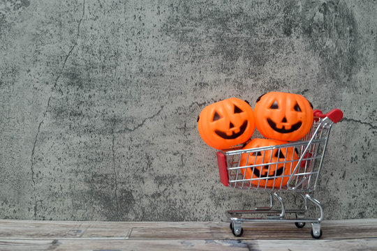 Halloween holiday background with Halloween accessories and costume on shopping cart , copy space