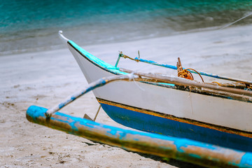 Close up of traditional banca fishermen boat on the beach. Nido, Philippines