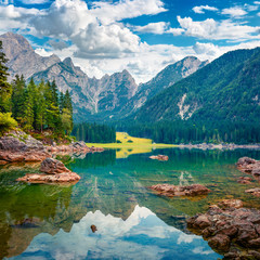 Foto op Canvas Landschappen Picturesque summer view of Fusine lake. Splendid morning scene of Julian Alps with Mangart peak on background, Province of Udine, Italy, Europe. Traveling concept background.