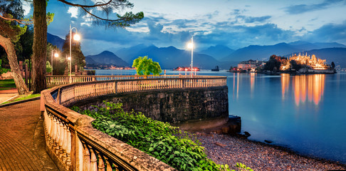 Foto auf Acrylglas Blau Jeans Great evening cityscape of Stresa town. Picturesque summer susnset on Maggiore lake with Bella island on background, Province of Verbano-Cusio-Ossola, Italy, Europe. Traveling concept background.