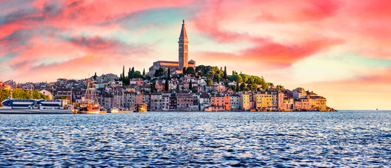 Fantastic spring sunset of Rovinj town, Croatian fishing port on the west coast of the Istrian peninsula. Impressive evening seascape of Adriatic Sea. Traveling concept background.
