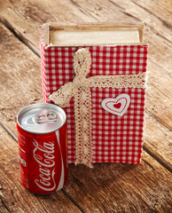 Can of Coca-cola and  book's secret recipe.