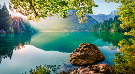 Foto op Aluminium Natuur Impressive morning view of Fusine lake. Attractive summer scene of Julian Alps with Mangart peak on background, Province of Udine, Italy, Europe. Traveling concept background.