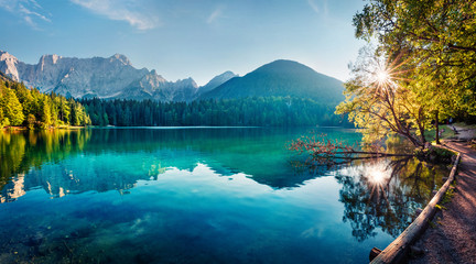 Spoed Foto op Canvas Bergen Colorful summer view of Fusine lake. Bright morning scene of Julian Alps with Mangart peak on background, Province of Udine, Italy, Europe. Traveling concept background.