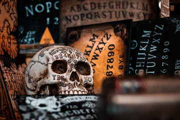 Talking board and planchette, also known as Ouija board, used for communicating with the dead and other spirits or deamons. Halloween background, hand made horror elements for Tv and cinema movies.