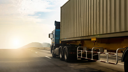 Cargo Truck on highway road with container, transportation concept.,import,export logistic industrial Transporting Land transport on the expressway againt sunrise sky