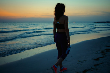 fitness sports woman with water walking after workout
