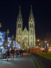 Prague, Czech Republic. Christmas market at Namesti Miru (Peace Square) in front of St. Ludmila Church in night.