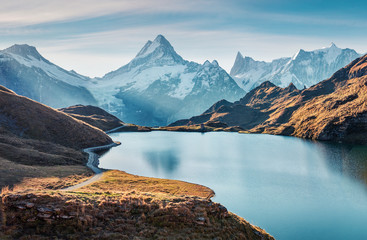 Tuinposter Bergen Gorgeous evening panorama of Bachalp lake / Bachalpsee, Switzerland. Exotic autumn sunrise in Swiss alps, Grindelwald, Bernese Oberland, Europe. Beauty of nature concept background.