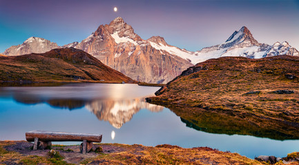 Fantastic evening landscape of Bachalp lake / Bachalpsee, Switzerland. Splendid autumn scene of Swiss alps, Grindelwald, Bernese Oberland, Europe. Beauty of nature concept background.