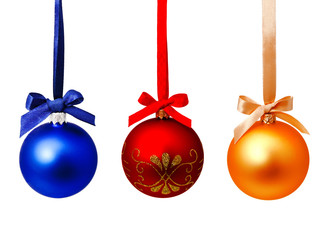 Perfect hunging red blue and gold yellow christmas balls isolated on a white