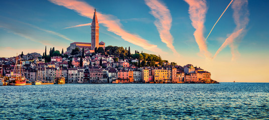Fantastic summer sunset on Rovinj town, Croatian fishing port on the west coast of the Istrian peninsula. Great evening seascape of Adriatic Sea. Traveling concept background.