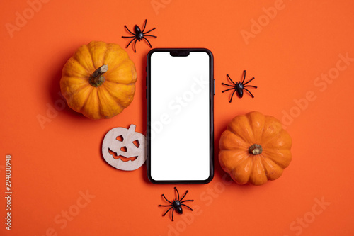 Blank white smartphone screen with pumpkins and spiders