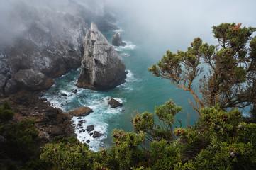 Lonely rock at rugged atlantic ocean coast in Sintra, Portugal