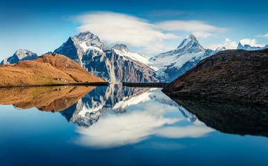 Splendid norning view of Bachalp lake / Bachalpsee, Switzerland. Fantastic autumn scene of Swiss alps, Grindelwald, Bernese Oberland, Europe. Beauty of nature concept background.