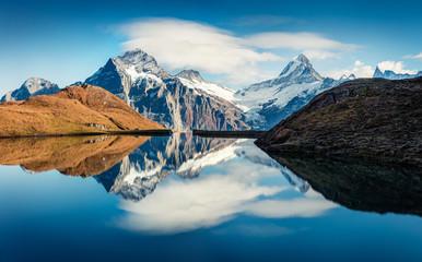 Fotobehang Alpen Splendid norning view of Bachalp lake / Bachalpsee, Switzerland. Fantastic autumn scene of Swiss alps, Grindelwald, Bernese Oberland, Europe. Beauty of nature concept background.