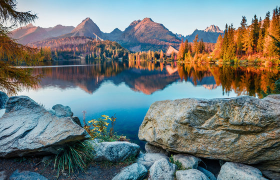 Exciting autumn view of Strbske pleso lake. Gorgeous evening scene of High Tatras National Park, Slovakia, Europe. Beauty of nature concept background.