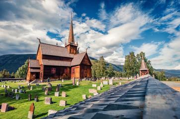Splendid summer view of Lom stave church (Lom Stavkyrkje). Sunny morning scene of Norwegian countryside, administrative centre of Lom municipality - Fossbergom, Norway, Europe.