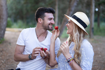 Happy young couple at picnic in nature