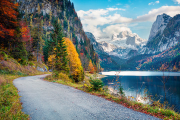 Amazing autumn scene of Vorderer / Gosausee lake with Dachstein glacieron background. Breathtaking morning view of Austrian Alps, Upper Austria, Europe. Traveling concept background.