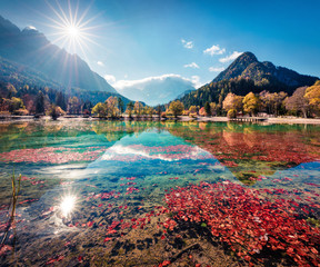 Foto auf Leinwand Dunkelbraun Gorgeous morning view of Jasna lake. Stunning autumn scene of Julian Alps, Gozd Martuljek location, Slovenia, Europe. Wonderful landscape of Triglav National Park. Traveling concept background.