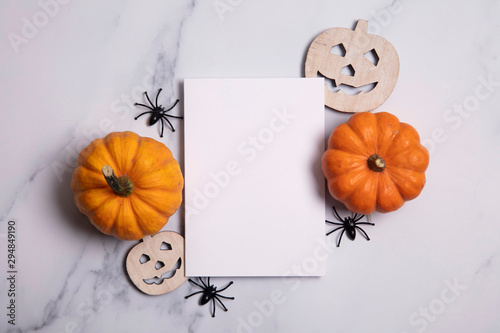 Blank white halloween card with pumpkins and spiders. Poster invitation mockup