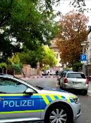 Police secure the area after a fatal shooting in Halle